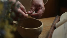 Close up of an old man making medicine from herbs stock footage