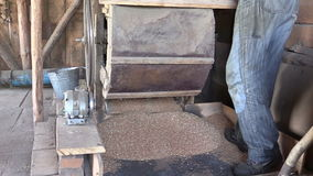 Close up of old manual grain cleansing harp machinery in barn stock footage