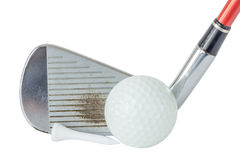 Close up the old metal golf club and ball with tee set on white Stock Photos