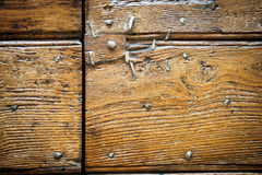 Close up of old metal nails in an ancient wooden door. Royalty Free Stock Photos