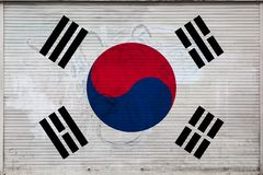 Close-up of old metal wall with national flag. Of South Korea. Concept of South Korea export-import, storage of goods and national delivery of goods. Flag in royalty free illustration