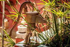 Close-up of an old metal water pump used decades ago Royalty Free Stock Photography