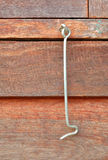 Close up the old metal window hook with wooden background in vin Royalty Free Stock Photography