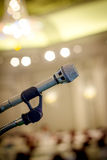 Close up old microphone in conference room with screen blur back Royalty Free Stock Images