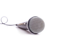 Close up old microphone isolated on white. Background stock photography