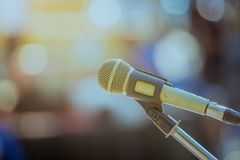 Close up the old microphone on stage in blur bokeh background. Close up the old microphone on stage in blur bokeh background Stock Image