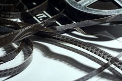 Close-up of old narrow films lying with a coil.  royalty free stock photo