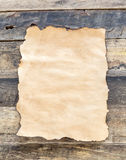 Close up old paper on wooden background Stock Photography