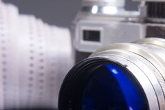 Close-up of old photo camera with a metal lens and viewfinder Royalty Free Stock Images