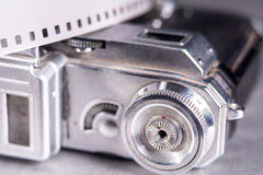 Close-up of old photo camera and photo film 35 mm on the backgro Royalty Free Stock Photos