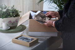 Close-up on old photographs. In the hands of widow stock images