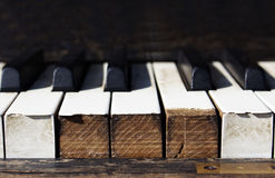 Close up old piano keys. Old vintage piano keys close up. white and black keys Royalty Free Stock Photography