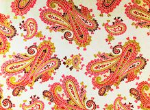 A close up of old printed paisley pattern. A colorful elaborate shabby chic  paisley patterned background Royalty Free Stock Image