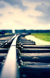 Close up of an old rail with stormy clouds duo toned Stock Image
