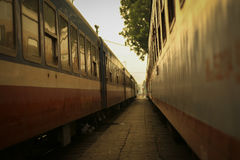 Close-up of old railroad cars with windows. Railroad cars with windows at Ha Noi station Royalty Free Stock Photo