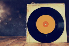 close up of old records on wooden table Royalty Free Stock Images