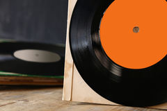 Close up of old records on wooden table Stock Images