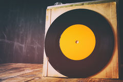 close up of old records on wooden table Stock Photos