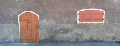Close up of old red door and window with red shutters royalty free stock image