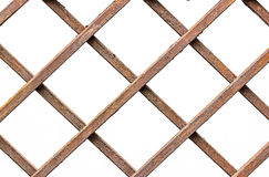 Close up old rusty brown metal fence pattern on white background.  royalty free stock photography