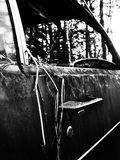 Close up of old rusty car. Black and white close up of old rusty car left in the field Stock Photos