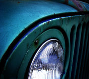 Close up of old rusty car. Close up of blue old rusty car left in the field Stock Photography