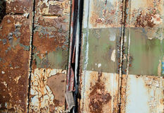 Close up of old rusty metal bus door background Royalty Free Stock Photo