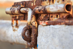 Close up old and rusty metal latch Royalty Free Stock Photo