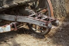 Close up of old rusty wooden wagon connecting mechanism, wheel v royalty free stock images