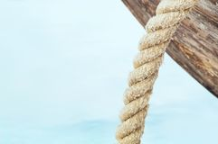 Close-up of an old ship with a rope on the water Stock Photos