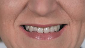 Close up of Old Smiling Woman with White Teeth stock video footage