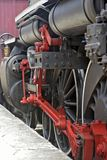 Close-up of old steam locomotive wheels, now tourist attraction Stock Photography