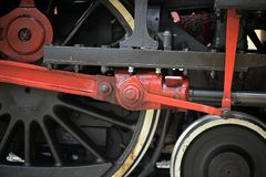 Close-up of old steam locomotive wheels, now tourist attraction Royalty Free Stock Images