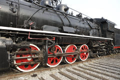 Close-up of old steam train. Close-up of an old steam train parking on the rail tracks Stock Image