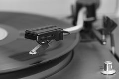 Old stereo vinyl record player. The stylus over a vinyl record. Close-up of a old stereo vinyl record player. The stylus over a vinyl record. Details royalty free stock image