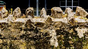 Close up of an old stone wall from a church. With moss, in Ireland, stone texture background stock image