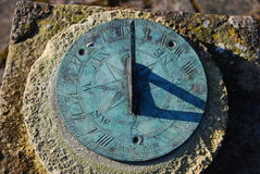Close up of old sundial with shadow Stock Photos