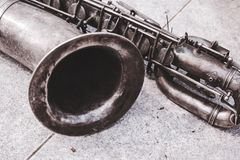 The old tenor saxophone in vintage look. Close up of the old tenor saxophone in vintage look stock images