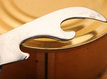 Close-up old tin opener opening a can Royalty Free Stock Image