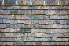 Close-up old traditional roof tiles from baked clay Royalty Free Stock Photo