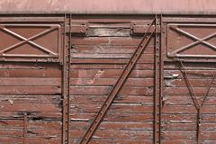 Close-up of an old train wagon. A close-up of an old train wagon which has not been used for a long time. Check out the fine detail. The paint is falling of, the royalty free stock photo