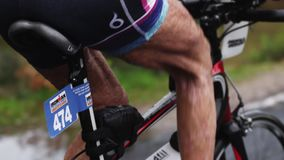 A close up of an old triathletes legs stock footage
