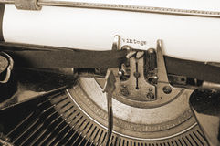 Close up of old typing machine and vintage text on paper, sepia Royalty Free Stock Images