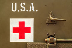 Close up of an old USA Army truck with red cross sign Royalty Free Stock Photos