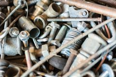 Close-up old used spare part, rust bolts and knots many sizes stock photography