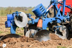 Old vintage blue plough at ploughing match Royalty Free Stock Photo