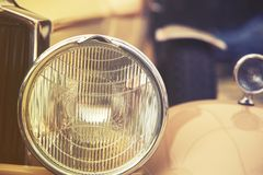 Close up on old vintage car, front light Stock Photo