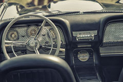 Close up on old vintage car steering wheel and cockpit Stock Photography
