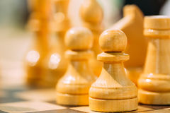 Close up of Old Vintage Chess On Wooden Chessboard Royalty Free Stock Photos