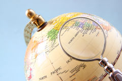Close up of old vintage globe and magnifying glass. Close up of old vintage globe and magnifying glass Royalty Free Stock Photo